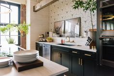"""If you've binge-watched Season 3 of Netflix's hit show """"Queer Eye,"""" you've seen the Fab Five's new loft in downtown Kansas City. Here's a look at the stylish space designed by Bobby Berk with West Elm products. West Elm, Fab Five, Kansas City Apartments, Clear Coffee Table, Style Loft, Loft Spaces, Cuisines Design, Small Tables, Interiores Design"""