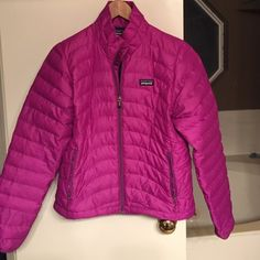 Patagonia down jacket Patagonia adult small down jacket. This is a reposh. I don't know much of the details but it is in used condition. I would say good/fair condition as it has signs of wear such as a small spot on each sleeve and black ink spot near zipper I will be posting more pictures when I get home later tonight. Price will reflect condition. Patagonia Jackets & Coats Puffers