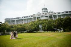 Grand Hotel tea garden lawn on Mackinac Island with wedding couple and daughter in Northern Michigan destination wedding venue by Paul Retherford Wedding Photography, http://www.PaulRetherford.com