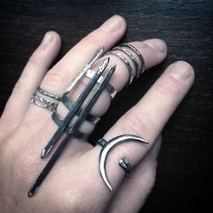 """huntergathererchicago: """"Claws  I am very pointy. @wolfandsadie Spire Rings, Theurgy Ring and some @noctex Collab Maneo Stacking Rings """""""