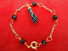 """Manita de azabache and coral, a traditional charm used against """"mal de ojo"""" / evil eye."""
