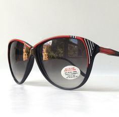 vintage 1980's NOS cat eye sunglasses black plastic frames fashion accessories womens sun glasses retro modern oversized red white stripes by RecycleBuyVintage on Etsy