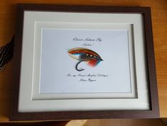 """A wonderfully tied and framed salmon fly """"Captain"""" tied by Klaus Woggon By Manfred Dillinger"""