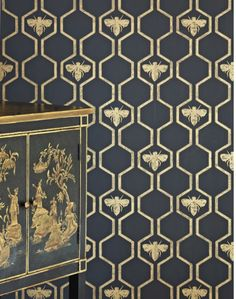 Gold Honey Bee Wallpaper Metallic and Luxurious & Stunning! This all over geometric trellis wallpaper design featuring motif's of honey bee's. Shown here in the charcoal and gold colorway. Wallpaper Stores, Wall Wallpaper, Wallpaper Online, Honeycomb Wallpaper, Trellis Wallpaper, Metallic Wallpaper, Geometric Wallpaper Kitchen, Wallpaper Staircase, Wallpaper Designs For Walls