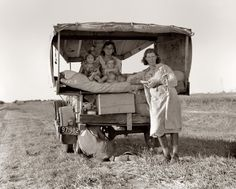 "August 1936. Family between Dallas and Austin, Texas. The people have left their home and connections in South Texas, and hope to reach the Arkansas Delta for work in the cotton fields. Penniless people. No food and three gallons of gas in the tank. The father is trying to repair a tire. Three children. Father says, ""It's tough but life's tough anyway you take it."" View full size. Photo by Dorothea Lange."
