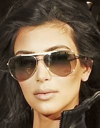 7f85a5daec Kim Kardashian was spotted wearing her Barton Perreira Breed Love Sunglasses