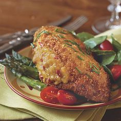 Pimiento Cheese-Stuffed Fried Chicken  This award-winning recipe takes ordinary fried chicken up a notch by melting pimiento cheese inside the chicken breasts. Garnish with freshly chopped chives and enjoy.