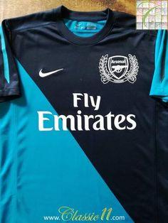 Official Nike Arsenal away football shirt from the 2011/2012 season.