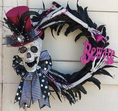 Skeleton wreath,Halloween wreath,Skull wreath,Black halloween wreath,Feather wreath,Pink skeleton wreath,Pink and black wreath,pink wreath by DesignsbySheilaB on Etsy https://www.etsy.com/listing/471159570/skeleton-wreathhalloween-wreathskull