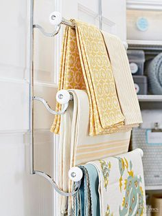 Over-the-door racks and rods are a great way to give yourself a little depth and height. Use them in space-challenged guest bathrooms or in small closets as a way to organize the next day's clothing./