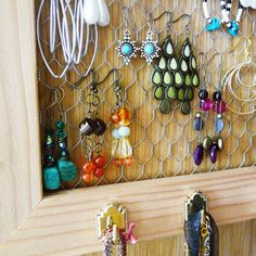 earring rack using chicken wire and an old wooden frame.