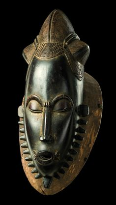 "Africa | Mask of the ""mblo"" group from the Baule people of the Ivory Coast 