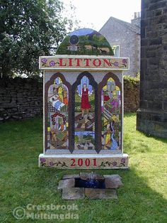 Litton welldressing, 2001. The Custom of Well Dressing is  unique to Derbyshire.  Origins and history are not certain but its roots are said to come from pagan customs of making offerings to Water Gods.  Many Wells were thought to have healing powers and during early Christian times offerings continued to be made.  The result was that Wells were dedicated to Christian Saints