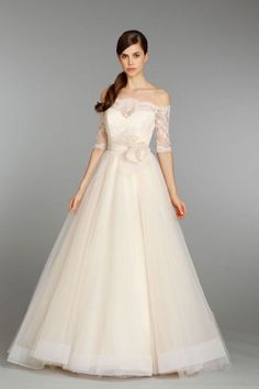 Sexiest Off The Shoulder Wedding Dresses - MODwedding - I'd wear a different belt. Glittery red or soft gold…something.