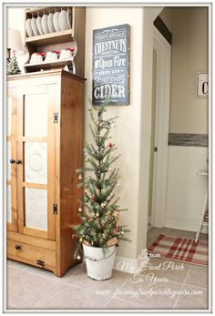 small decorated Holiday / Christmas tree in a bucket.  perfect for a country kitchen