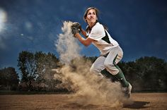 SPP_3.jpg --- This is a very good action shot because not only does it have a new perspective, it also has the dirt rising which leads us to the subject and captures the moment right as it's happening. I'd use this for a softball/baseball spread, and possibly a divider.