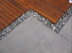ground decking with rock and concrete, def doing this when we remodel next spring!