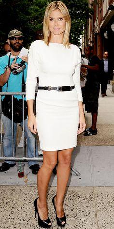 Heidi Klum in LWD, harness belt and platform peep-toes.