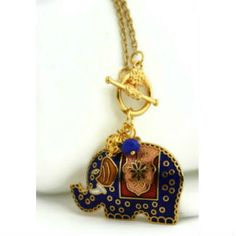 The Happy Blue Elephant Necklace by Ahkriti $40