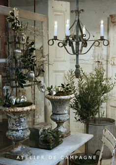 ancient urns, wrought iron chandelier, vintage doors - gorgeous!