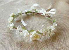 Dainty flower crown with tiny ivory roses on twisted white berry vines, a delicate accessory for flower girls, first communion or confirmation, first birthday photo shoots, and any photo shoot opportunities!  I used small handmade paper roses and little pip berries, as well as natural dried babys breath flowers for an added romantic touch. The crown is open-ended and can be tied on the back with an ivory ribbon (included). You can also take the ribbon off and secure the ends under your…