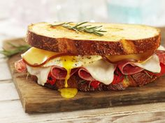 smoked gouda, provolone, salami, roasted red peppers, over easy egg, on aritsan bread