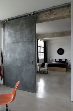 polished concrete floors and steel barn door -- love industrial look Industrial Door, Industrial Bedroom, Industrial Interiors, Industrial Chic, Industrial Restaurant, Industrial Apartment, Industrial Office, Industrial Wallpaper, Industrial Farmhouse