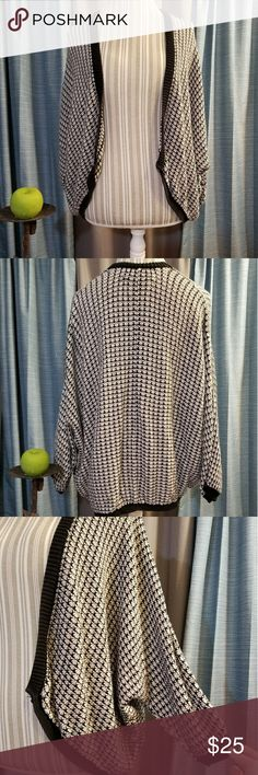 🌻🌺🌻ANN TAYLOR LOFT KNIT CARDIGAN/COVERUP!! SIZE:large   BRAND:Ann Taylor   CONDITION:good, please refer to 4th pic as the black trim has some fading to it   COLOR:cream and black  Cute batwing sleeves    🌟POSH AMBASSADOR, BUY WITH CONFIDENCE!   🌟CHECK OUT MY OTHER ITEMS TO BUNDLE AND SAVE ON SHIPPING!   🌟OFFERS WELCOME!   🌟FAST SHIPPING! Ann Taylor Sweaters