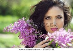 Young brunette woman with lilac flowers, Outdoors portrait
