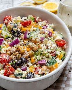 clean food crush Greek Chickpea Salad Tzatziki Dressing for a Plant-Based Protein Boost! Greek Chickpea Salad, Greek Salad, Chickpea Ideas, Quinoa Salad, Salad Recipes, Healthy Recipes, Healthy Foods, Healthy Eating, Thm Recipes