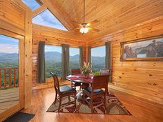 Floating in the Smoky Mountain view, dining area of Cozy Den cabin