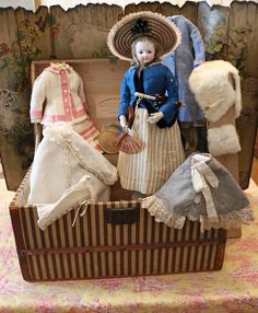 Early Jumeau Fashion doll with trunk of beautiful clothing