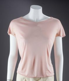 """Marilyn's pink silk Pucci blouse with cap sleeves. Label reads, """"Emilio Pucci/ Florence, Italy/ 100% Pure Silk"""" ~  """"Property From the Estate of Marilyn Monroe,"""" Julien's Auctions"""