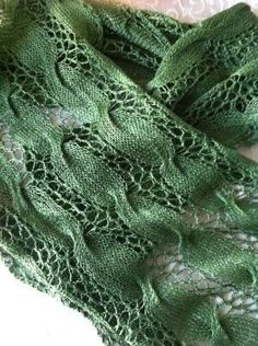 Free Knitting Pattern for Easy Jubilee Scarf - Lace and cable scarf using mostly an easy 2 row repeat of eyelet lace border and stockinette, with all wrong side rows as rest rows. There's one cable row about every 20 rows. Fingering or lace weight yarn. Designed by Norah Gaughan for Berroco. Pictured project by yarnandflowers Rated easy by Ravelrers. Great lightweight scarf for spring and summer by lucinda