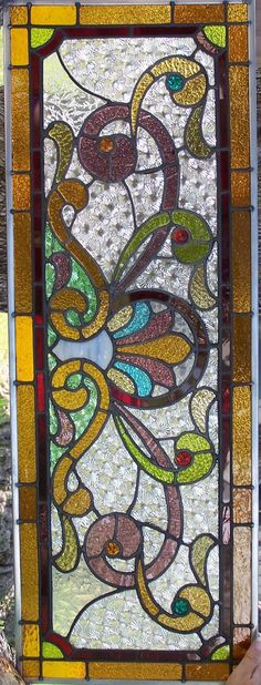 Phoenix-ArtGlass - REPAIRSThis 100-year-old panel was very dirty and broken before repair.This is the finished repair...