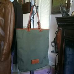 Dooney & Bourke bag Very good condition -olive w/yellow interior Dooney & Bourke Bags Crossbody Bags