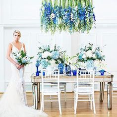 """Hello, blue beauty! The design of this #tablescape and #bouquet prove that there are no limits to your """"something blue""""! See more from this styled shoot on WedLuxe.com and in our new W/S 2017 issue that's on newsstands NOW! (: @deniselinphoto, co-concept creator and planner: @shingweddings, co-concept creator and decor: @aotpvan, floral: @flowerfactory, gown: @galialahav from @bisou_bridal, beauty: @anitaleehairmakeup, jewellery: #elsacorsi from @jewelietteshop)"""