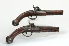 A Pair of Carved and Silver Inlaid Dueling Pistols, Giuseppe Merli, early 18th C.