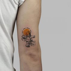 Lego tattoo on the back of the right arm.