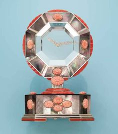 Cartier mystery clock made of red and pink coral, diamonds, mother-of-pearl and rock crystal