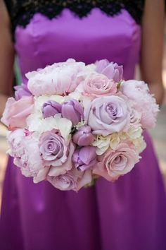 Perfect bouquet of roses, tulips, and peonies in shades of lilac, light pink, and white.for a purple wedding ~ Inside Weddings
