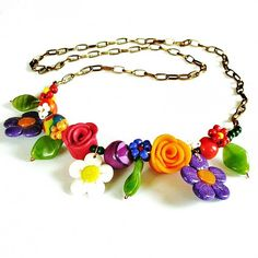 Idea: Necklace of fimo flowers and seed bead flowers. No pattern link.