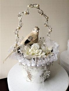 This is a gorgeous handcrafted large painted peat pot that was made into a basket - turned out so pretty. Could be used for Easter/wedding/ shower decor. Painted shabby white and filled with Spanish moss. The dangling crystals and ribbons were added around the upper edge. A white