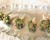Boutonnieres, sedum and succulents with accents of peach statice and babies breath