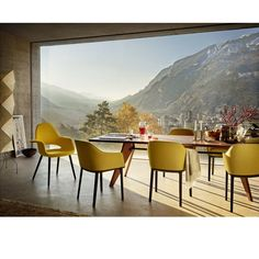 Jean Prouve Table Solvay With Eames Organic and Bouroullec Softshell Chairs Vitra