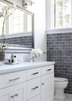 Master Bathroom - OOOHHHH, white cabinets with silver hardware, grey blend subway tiles.  This may be too modern for us
