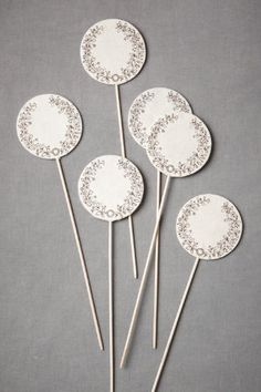 Great Idea...Make them out of lollipop sticks and the card stock of your choice.