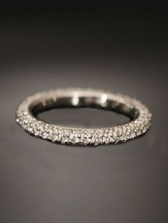 Michael B. Platinum Princess Collection Handmade Eternity Band. Three sided micro pave set diamond eternity band with diamonds equaling approximately 1.52ct total weight. Available at London Jewelers!