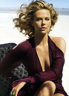 "Photos of Charlize Theron, one of the hottest girls in movies and TV. Charlize's first major role was in the movie ""2 Days in the Valley"". She has since been in such movies as ""The Devil's Advocate"", ""Aeon Flux"" and ""Hancock"". Charlize has also been on T..."