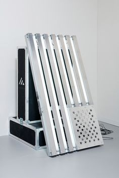 prefaces:    Banks Violette,  Not Yet Titled (Flag Edition)fluorescent tubes, road cases, aluminium, electrical wires, assorted hardware170.2 x 91.4 x 76.2 cm 2010. via: maureenpaley.com